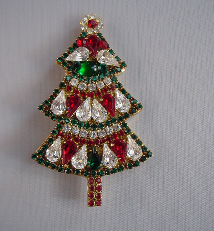 BEE GEE Christmas tree brooch with red, clear and green rhinestones set in  gold tone, 3-1/8