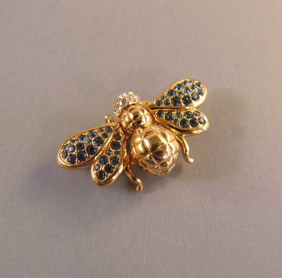 Pin With Blue Rhinestone Wings And A Clear Head In Gold Plate Finish 1 5 8 By 7 It Has The Swan Copyright Mark On Back