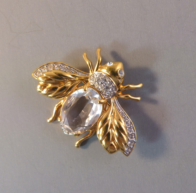 SWAROVSKI clear unfoiled crystal insect brooch with clear rhinestones in a  hand polished gold plated setting. 6fea9a258