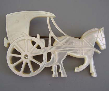 "MOTHER-OF-PEARL carved carriage and horse brooch, 2-2/3""."