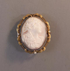 a9fa2a787 EDWARDIAN 10k pink conch shell cameo brooch of a classical lady's profile  set in 10 karat yellow gold setting adorned with leaf shapes, circa 1900,  ...
